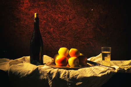 A bottle of wine with four apples and a glass. Stok Fotoğraf