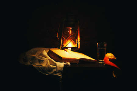 A book and a lamp in the dark.
