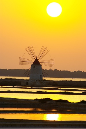 Windmill at saline, Marsala, southwest Sicily, Italy photo