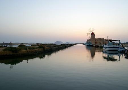 Windmill at saline, Marsala, southwest Sicily, Italy photo