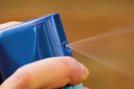 fungicide: Finger presses the button and the spray can sprays Stock Photo