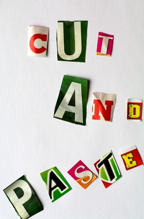 cut and paste: Cut and paste illustrated with letters cut from different newspapers