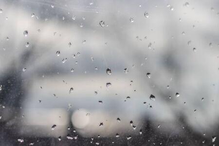 Raindrops on glass, wet city window, rain in the city outside the window Archivio Fotografico