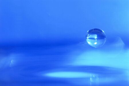 A Blue Drop of Water - spacey Stock Photo