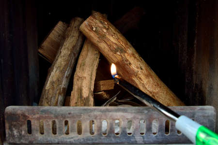 Turning on the fire in the furnace: the lighter Stock Photo