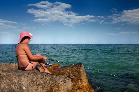 Beautiful summer day, woman fishing  photo