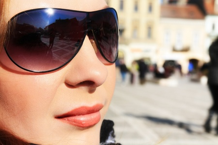 Beautiful brunette woman with sunglases. Stock Photo