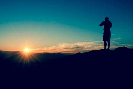 proposito: Silueta en la puesta del sol Foto de archivo