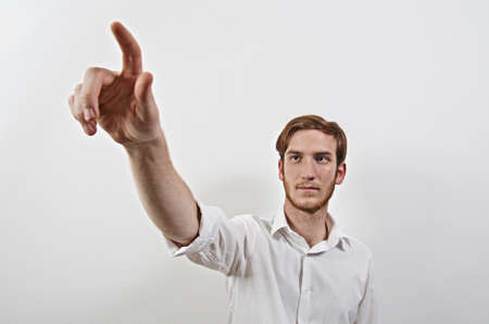Young Adult Male in White Shirt Pointing with His Finger