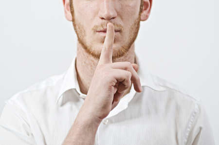 Be Quiet - Young Adult Male in White Shirt Gestures