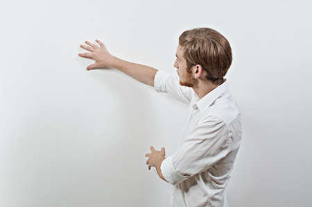 white poster: Young Adult Male in White Shirt Gesturing, Showing, Teaching