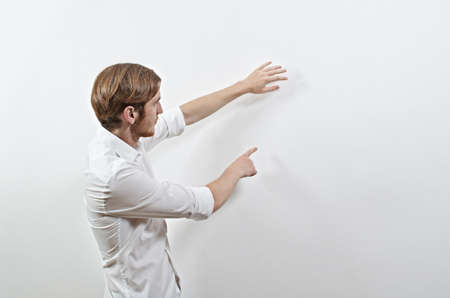 gesturing: Young Adult Male in White Shirt Gesturing, Showing, Teaching