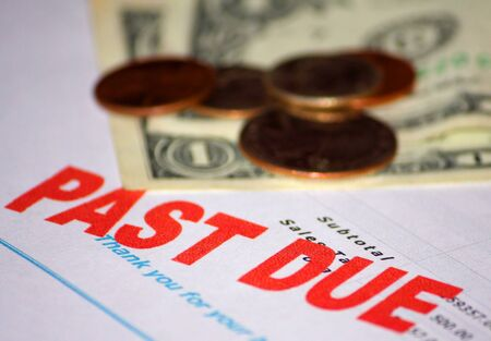 Past due notice showing only a few dollars and change available. Stock Photo
