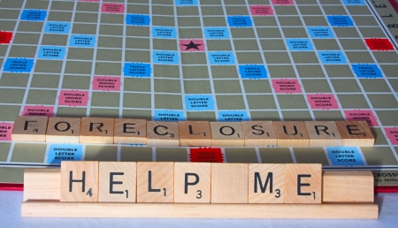 foreclosure: A cry for financial help spelled out on a board game.