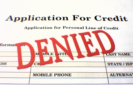 rejected: Personal loan application stamped Denied in bold red ink. Stock Photo