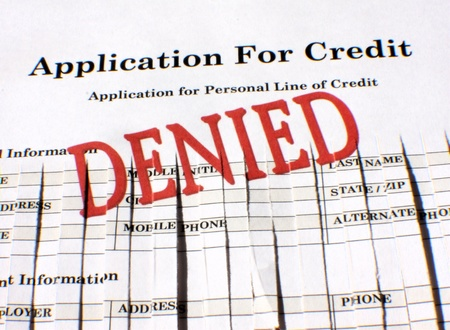 rejected: Partially shredded application for personal line of credit.