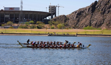Two boats racing along Tempe Town Lake during the Dragon Boat Festival 2012