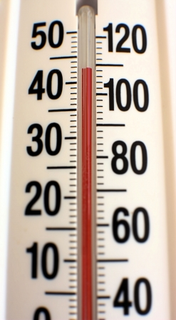 Outdoor thermometer showing unusually hot summer temperatures. Zdjęcie Seryjne