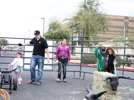 Children practice roping at Queen Creek Block Party, Queen Creek, Arizona