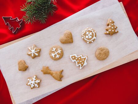 Fresh gingerbread cookies in kitchen table with powder,anise,cinnamon.Traditional sweet dessert for Christmas Holiday celebration. 版權商用圖片
