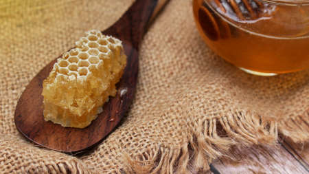 Honey is nutritious for health, stirring with a honey spoon and honeycomb