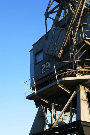 dockside: Bristol dockside crane against a clear blue sky. Space for text in the sky. Stock Photo