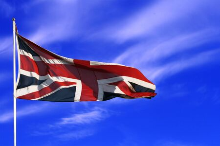 to flit: British union flag with blue sky and light clouds