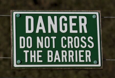 Sign saying do not cross the barrier