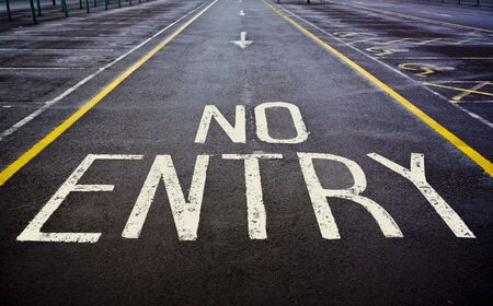 no skid: No entry sign painted on road Stock Photo