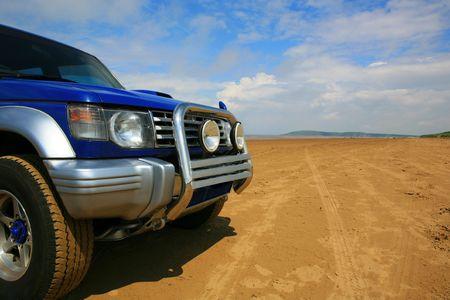 4 x 4 on deserted beach