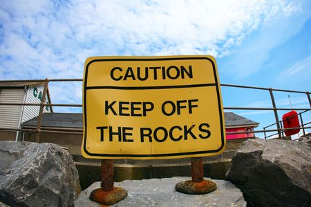 brean: fish eye wide angle view of Keep of the rocks sign on beach