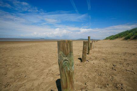 brean down: Wooden posts on beach