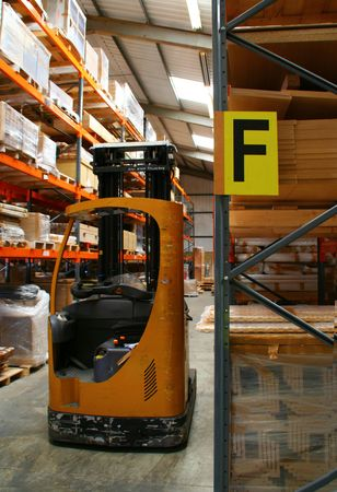 Fork Lift Truck in Warehouse