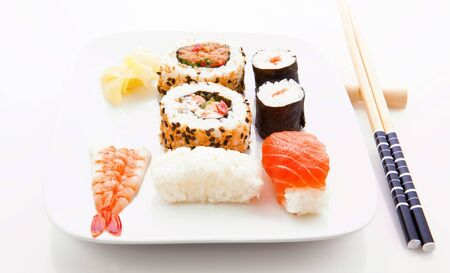 sushi plate: Sushi with white plate and chopsticks Stock Photo