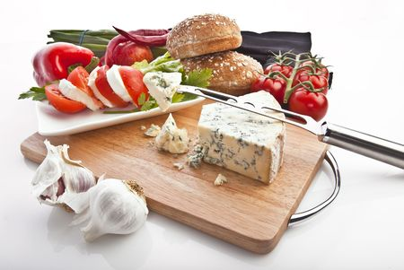 delicious vine tomatoes, bread and cheese on wooden board photo