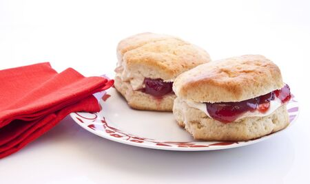 Home-baked scones with strawberry jam and clotted cream, often served with a cup of tea. Known as a cream tea. photo