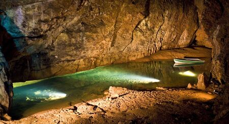 palaeolithic: Undergroung cave interior with boat Stock Photo