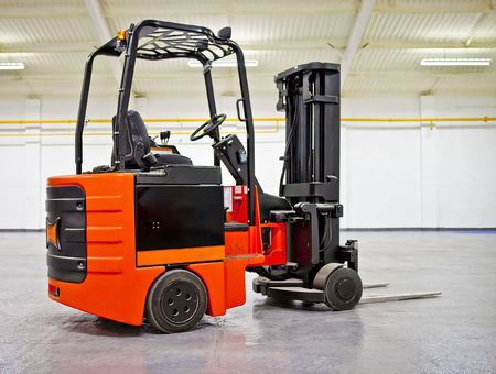 Fork Lift Truck in empty Warehouse