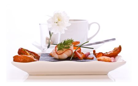 Dish of Smoked Salmon and Prawns with sun dried tomatos photo