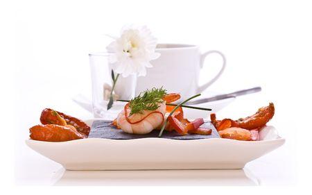 Dish of Smoked Salmon and Prawns with sun dried tomatos photo
