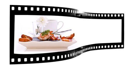 Dish of Smoked Salmon and Prawns with sun dried tomatos  film strip Stock Photo