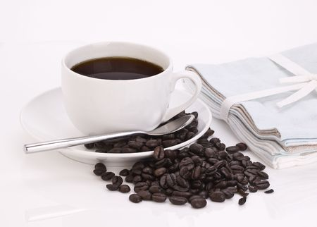 Coffee Cup with spoon and Coffee beans photo