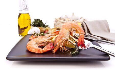 Barbequed prawn salad with lemon, macro closeup