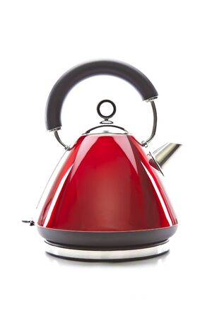 Red electric kettle isolated on white background photo