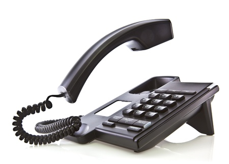 landlines: Black phone with floating handset  Stock Photo