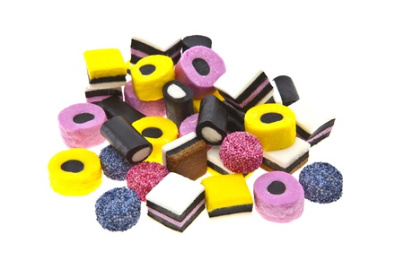 laxative: Liquorice allsort sweets in colourful abstract stack design isolated over white background.