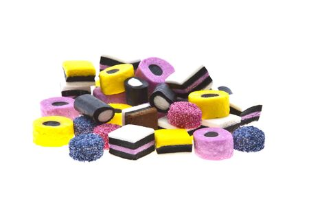 Selection of liquorice sweets in colourful abstract stack design isolated over white background.