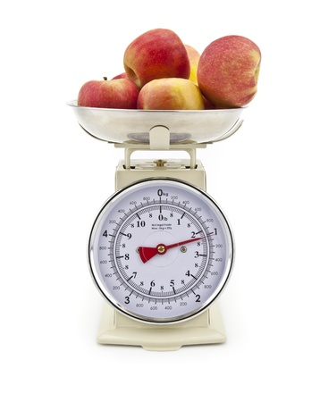 Old style kitchen scales with Apples on white background Isolated photo