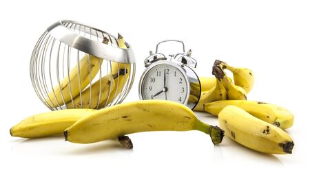 Banana Time clock with bananas on white background photo