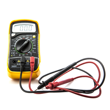 Digital multimeter on white background photo